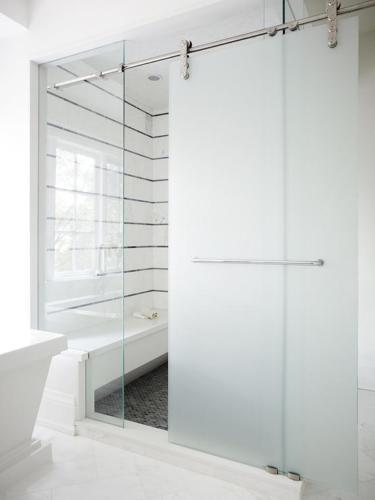 frosted-glass-sliding-shower-door-on-rails-black-white-striped-tiles